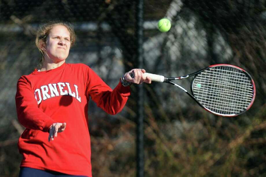 Margaux Stamm plays tennis during practice Tuesday, March 29, 2011. Photo: Lindsay Niegelberg / Connecticut Post