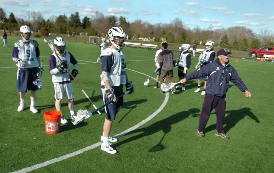 Spring sports preview at Staples High School in Westport, Conn. on Tuesday March 29, 2011. Head coach Paul McMulty, at right, before a boys lacrosse scrimage against Iona Prep. Photo: Christian Abraham / Connecticut Post