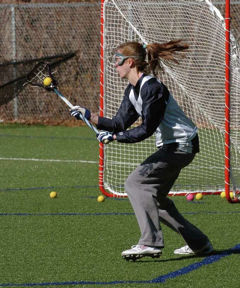 Spring sports preview at Staples High School in Westport, Conn. on Tuesday March 29, 2011. Elizabeth Driscoll at girls lacrosse practice. Photo: Christian Abraham / Connecticut Post