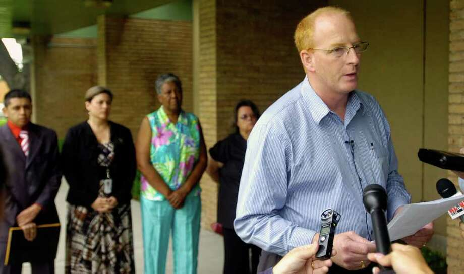 "Mike Neil, Co-chairperson of the ""Better"" group and also running for the District 5 seat, did most of the speaking at a news conference held Monday  outside the BISD Administration building.  Other candidates running for seats on the BISD school board were also in attendence behind him: Luis Lopez, left, representing Marcelino Rodriguez; Paula Blazek, Linda Gilmore and Donna Forgas, right. The group sought to refute and clarify comments BISD spokeswoman Jessie Haynes made during Friday's introduction of her new assistant.  Dave Ryan/The Enterprise Photo: Dave Ryan / Beaumont"