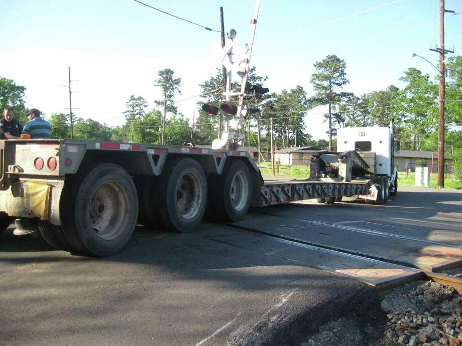 An 18-wheeler was stuck on train tracks at Garner and Helbig roads in north Beaumont.. Teresa Mioli/The Enterprise