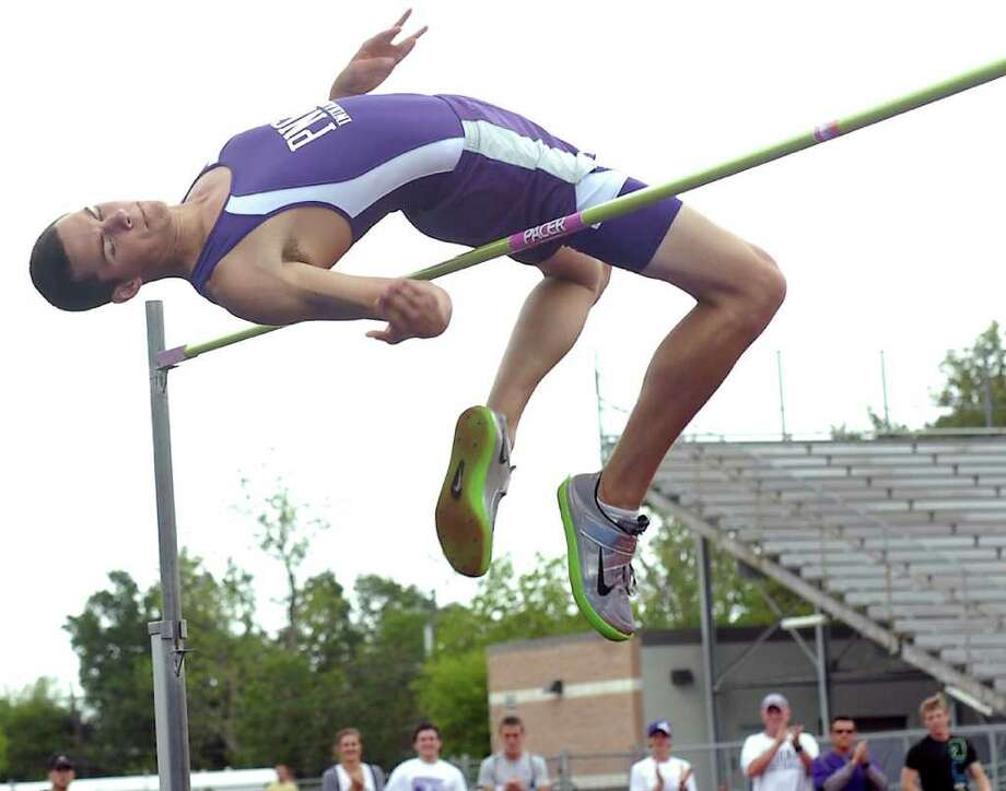 Dylan Richards, of Port Neches-Groves High School, makes his last attempt at the High Jump bar set at 6 feet, 10 inches. He had already won the event when the bar was set at the 6 foot 8 inch mark. The District 20-4A track and field event started Monday at PN-G High School. Monday was the day for the finals in field events and prelims for the running events. Dave Ryan/The Enterprise Photo: Dave Ryan / Beaumont
