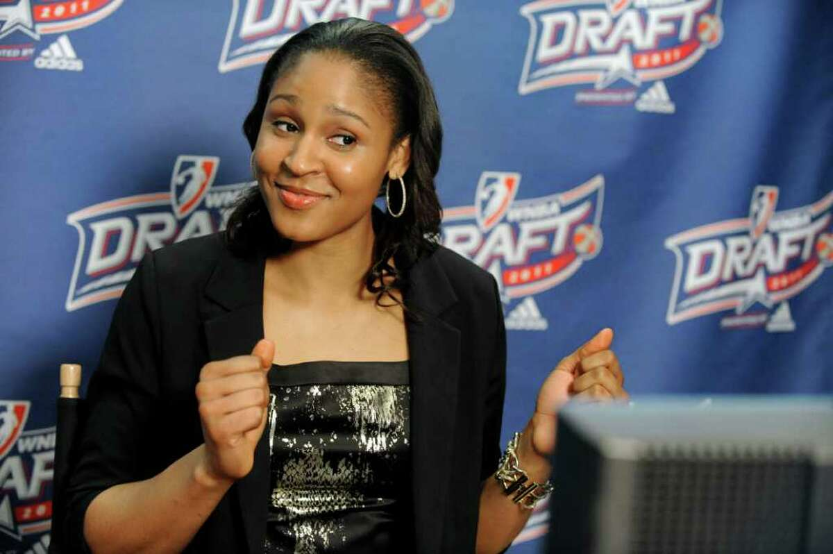 Connecticut's Maya Moore talks with fans in Minnesota via the Internet after being chosen by the Minnesota Lynx with the No. 1 pick in the WNBA basketball draft in Bristol, Conn., Monday, April 11, 2011. (AP Photo/Jessica Hill)