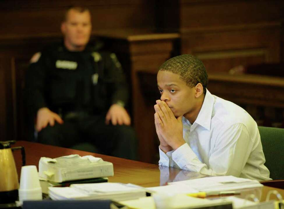 Ayerius Benson sits in the courtroom of Judge Andrew Ceresia in Troy, N.Y. April 11, 2011, where he is standing trial for the alleged murder of Turhan Tate April 15, 2010. (Skip Dickstein / Times Union)