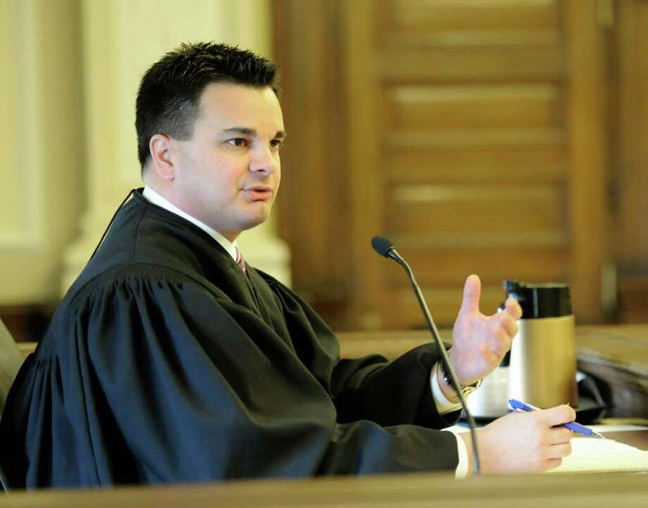 Judge Andrew Ceresia speaks to the jury in the Ayerius Benson murder case in Troy, N.Y. April 11, 2011. (Skip Dickstein / Times Union) Photo: Skip Dickstein