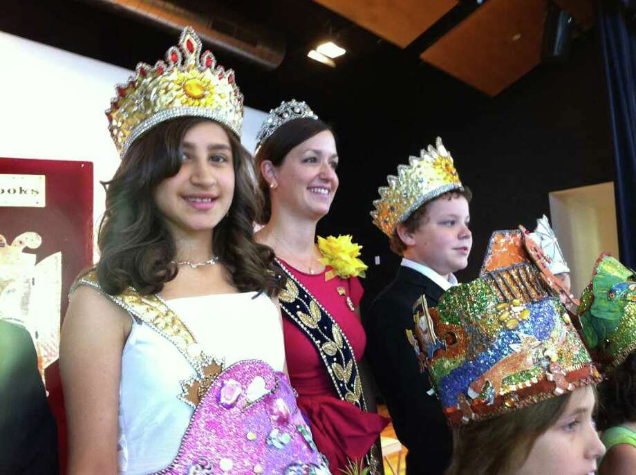 Left to right, fifth grader Alizae Alexys Olivan, the Queen of Enduring Spirit, Molly Chittim White, Mistress of Ceremony, and fourth grader Jacob Max Elkins, King of Magical Realms, celebrate Sunshine Cottage School for Deaf Children�s 2011 Fiesta Coronation of �The Court of Children�s Books,� on Monday. Photo: Jennifer R. Lloyd, Jennifer R. Lloyd/Express-News