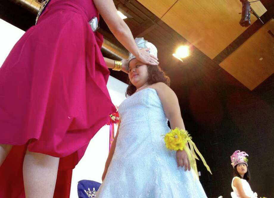 Alexandra Valentina Brkic, a student at Sunshine Cottage School for Deaf Children, was crowned the Princess of Resilient Delicacy with a crown representing �Charlotte�s Web� at the school�s 2011 Fiesta Coronation of �The Court of Children�s Books,� on Monday. Photo: Jennifer R. Lloyd, Jennifer R. Lloyd/Express-News