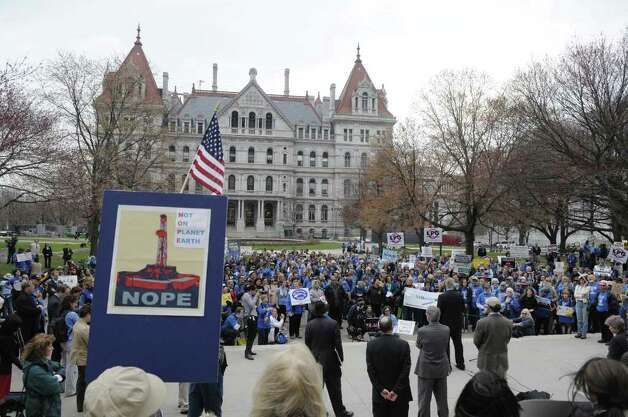 Protestors hold a rally on Monday morning, April 11, 2011 at the capitol in Albany.  New Yorkers from around the state came to the capitol to  call on state leaders to safeguard  the health of people and the environment from gas drilling called hydraulic fracturing.   (Paul Buckowski / Times Union) Photo: Paul Buckowski  / 00012681A