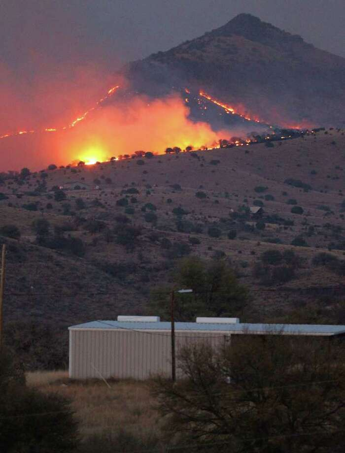 A wildfire burns on State Highway 118 near the McDonald Observatory not far from Ft. Davis, Texas. Wildfires have been buring out of control in West Texas since Saturday. JOHN DAVENPORT/jdavenport@express-news.net Photo: John Davenport/Express-News