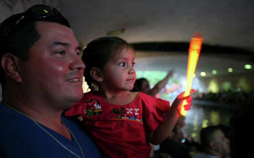 FOR METRO - George Valdez and his daughter Cattalina Valdez, 3,  watch the Texas Cavaliers' River Pa