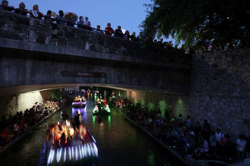 FOR METRO - Specators watch floats pass during the Texas Cavaliers' River Parade Monday April 11, 20