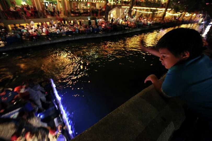 FOR METRO - Derek Hernandez, 12,  watches a float pass during the Texas Cavaliers' River Parade Mond