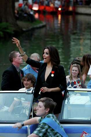 METRO -- Parade Marshall Eva Longoria waves to the crowd during the 80th annual Texas Cavalier River Parade, Monday, April 11, 2011. JERRY LARA/glara@express-news.net Photo: JERRY LARA, Express-News / SAN ANTONIO EXPRESS-NEWS