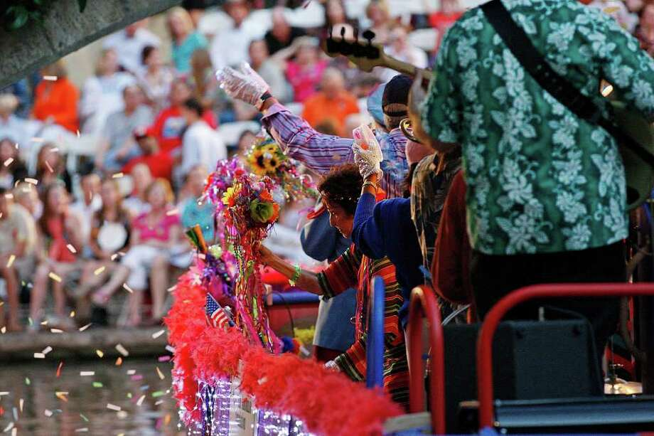 METRO The Fiesta San Antonio Commission float makes goes by the Arneson River Theatre during the 80th annual Texas Cavalier River Parade, Monday, April 11, 2011. JERRY LARA/glara@express-news.net Photo: JERRY LARA, Express-News / SAN ANTONIO EXPRESS-NEWS