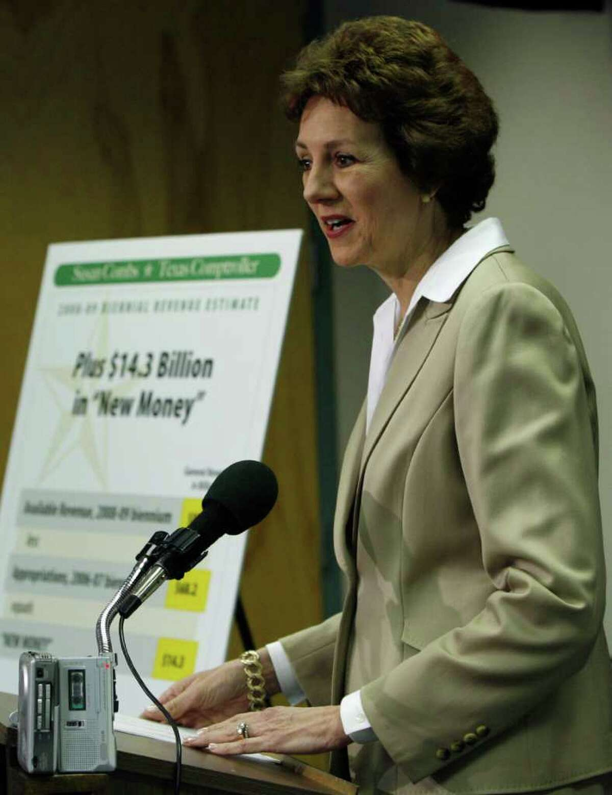 Texas Comptroller Susan Combs speaks during a news conference Monday, Jan. 8, 2007, in Austin, Texas. She announced that Texas has $14.3 billion in new money to spend in the coming two years but some economic sectors are cooling and lawmakers should be cautious in crafting a budget.