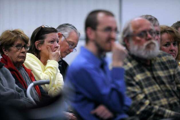 Fern Fullmer, second from left, of Niantic, listens to Millstone Power Station officials address members of the public to discuss safety issues in comparison to the nuclear disaster in Japan and possible ramifications on legislative tax proposals on Millstone, at the Town Hall in Waterford, Conn.,  Monday, April 11, 2011. (AP Photo/The Day, Tim Martin) Photo: Tim Martin, AP / The Day Publishing Company