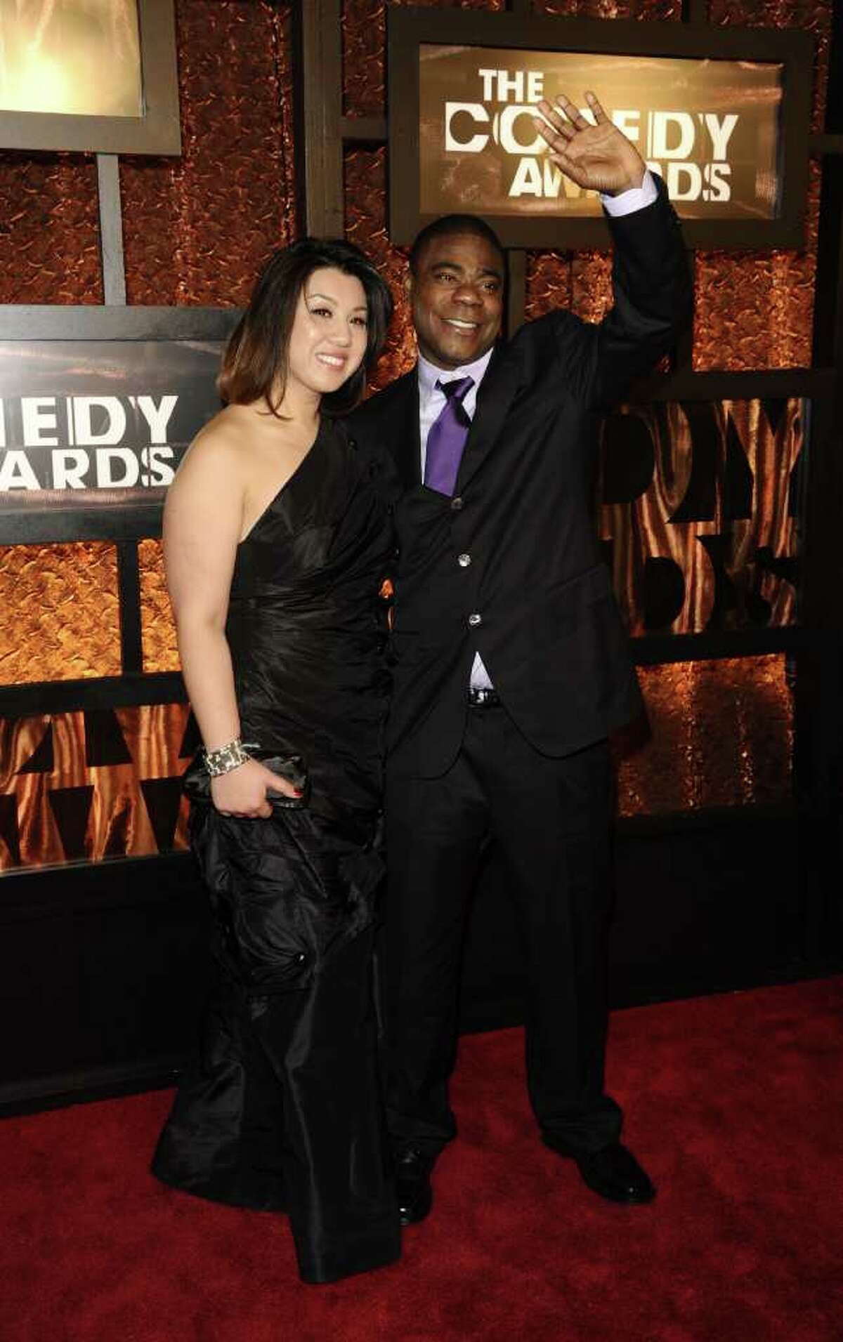 Actor Tracy Morgan, right, and his date Linda Trang attend the first annual