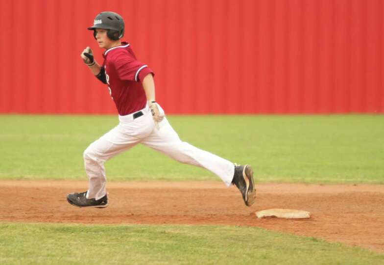 Jacob Soisson rounds second base during last Friday's victory over Kirbyville