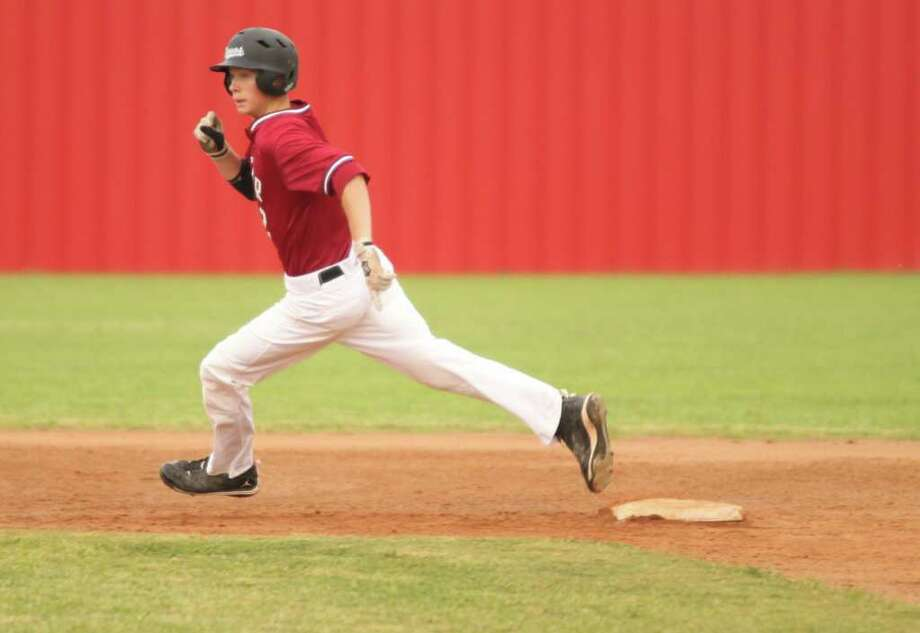 Jacob Soisson rounds second base during last Friday's victory over Kirbyville Photo: Jason Dunn