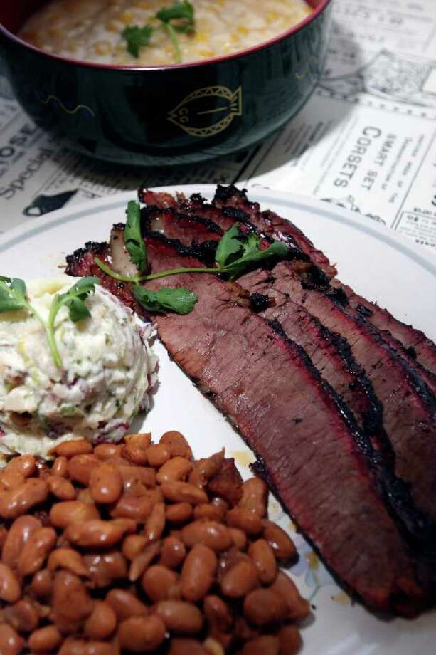 The namesake brisket is served with beans and red potato salad on the single meat plate at Texas Brisket BBQ. Photo: EDWARD A. ORNELAS, SAN ANTONIO EXPRESS-NEWS / SAN ANTONIO EXPRESS-NEWS NFS