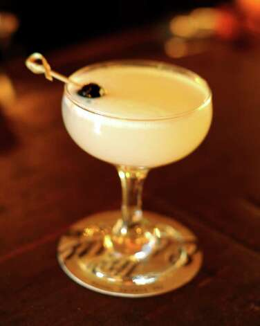 The Corpse Reviver No. 69, as mixed at The Esquire, contains Tenneyson, Absinthe Royale, St. Germain, orange liqueur and lemon. Photo: BILLY CALZADA, SAN ANTONIO EXPRESS-NEWS / gcalzada@express-news.net
