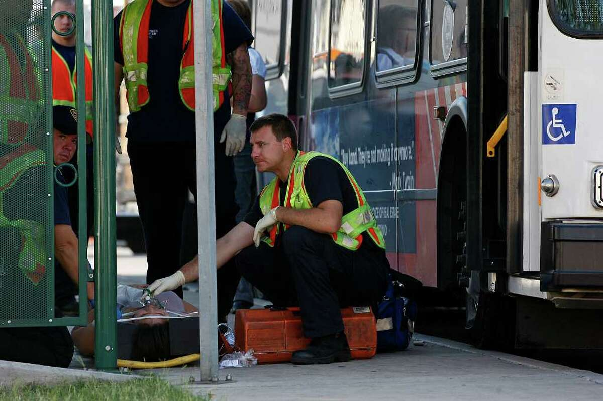 METRO -- San Antonio emergency personnel work on victims of a two-bus accident along westbound access road of Northwest Loop 410 near Exchange Parkway, Tuesday, April 12, 2011. Nine people suffered injuries not thought to be life-threatening Tuesday morning, when an empty Northside Independent School District bus rear-ended a VIA Metropolitan Transit bus on the Northwest Side. The crash took place around 8 a.m. JERRY LARA/glara@express-news.net