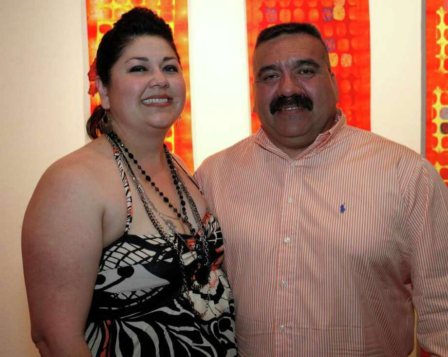 FEATURES; TRENDS FIESTA DO JMS; 04/08/11; From the left, Jennifer and Joe Mireles at Fiesta Do, Benefitting the Battered Women's and Children's Center, Friday, April 8, 2011 at The Radius Center in San Antonio. ( Photo by J. Michael Short / SPECIAL ) Photo: J. Michael Short, SPECIAL TO THE EXPRESS-NEWS / THE SAN ANTONIO EXPRESS-NEWS