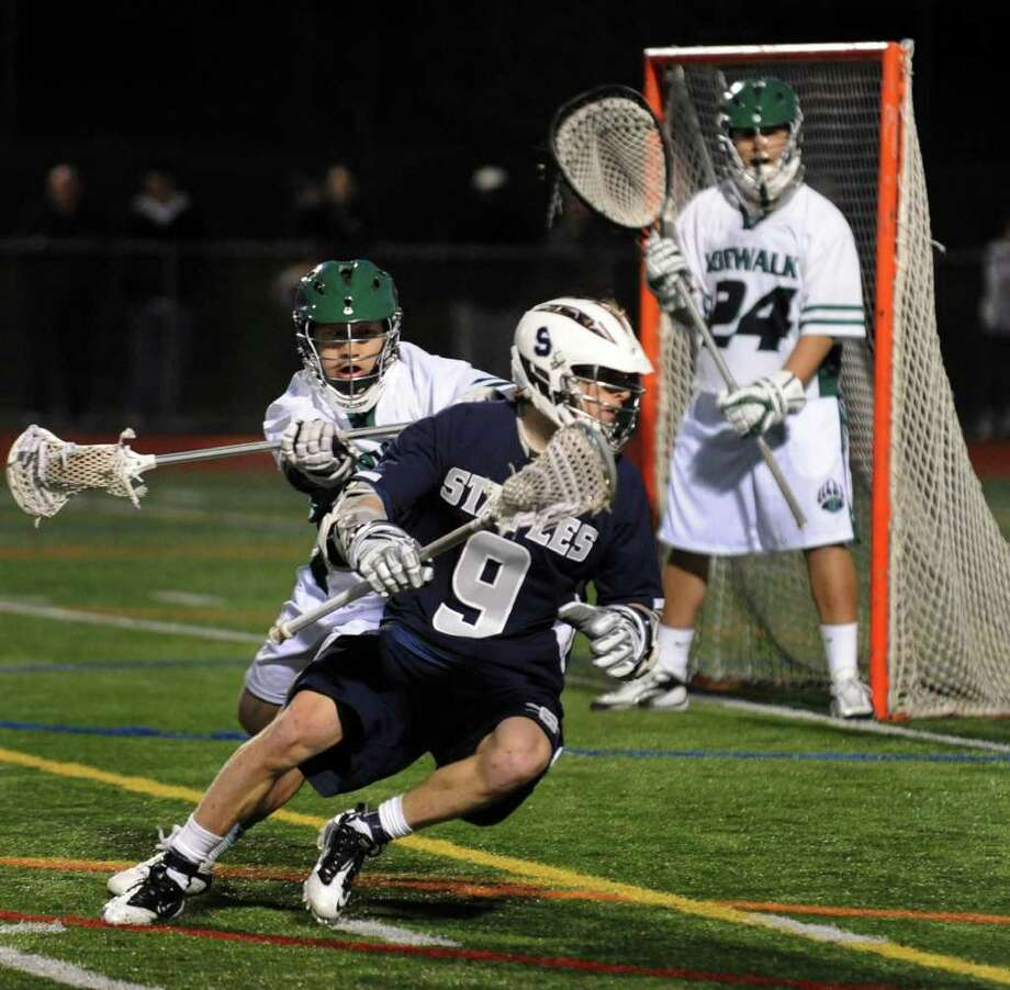 Highlights from boys lacrosse between Staples and Norwalk in Norwalk, Conn. on Thursday April 7, 2011. Staples' #9 Charlie Ross. Photo: Christian Abraham / Connecticut Post