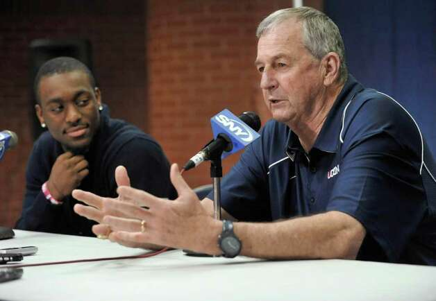 Connecticut coach Jim Calhoun speaks after Kemba Walker, left, announced that he will enter the NBA  basketball draft, in Storrs, Conn., Tuesday, April 12, 2011. (AP Photo/Jessica Hill) Photo: AP