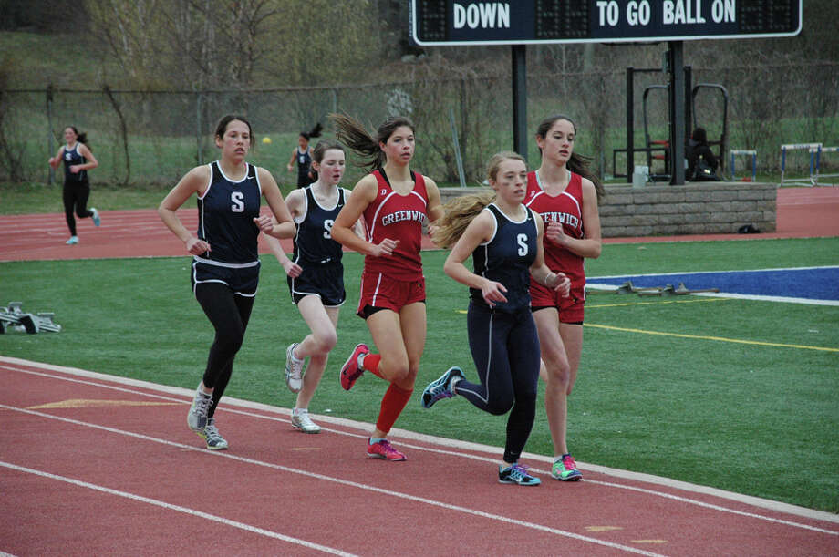 Staples sophomore Georgia Kursten leads junior Alex Popkin and freshman Caroline Koenig in the mile against Greenwich last Wednesday. Kursten won the 800 meters and Koenig triumphed in the 2-mile Monday in a tri-meet sweep over host Brien McMahon and Bridgeport Central. Photo: Contributed Photo / Staplesrunning.com