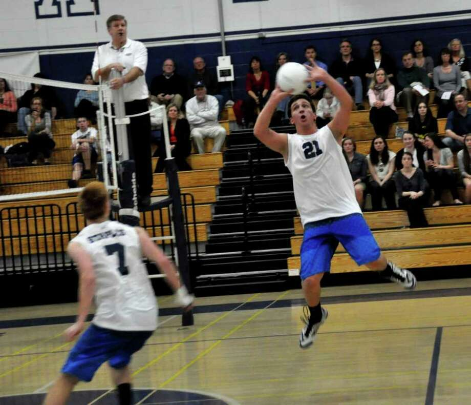 Staples senior quad-captain Danny Fishman had 38 assists and four kills Monday in a 3-2 loss to Masuk. Photo: Contributed Photo / Suzanne Kalb