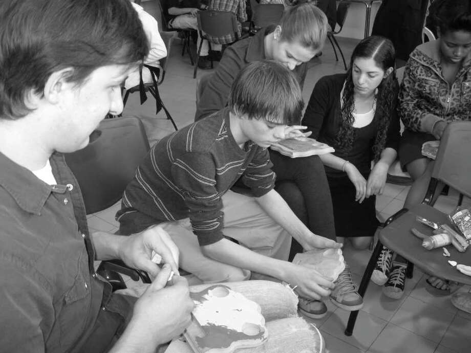 Connor Hegarty, a member of the Greenwich High School Israel Club, makes a candle-holder with other teenagers from Yemin Orde, an orphanage in the Carmel Forest during ht eclub's recent trip to Israel. Photo: Contributed Photo / Greenwich Citizen
