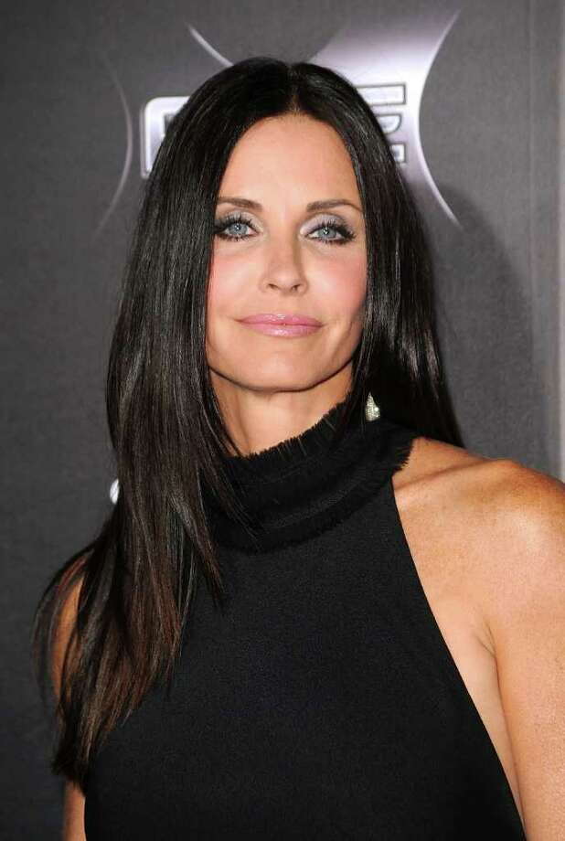 "Actress Courteney Cox arrives at the premiere of the Weinstein Company's ""Scream 4"" at Grauman's Chinese Theatre in Hollywood, California.  Photo: Frazer Harrison, Getty Images / 2011 Getty Images"