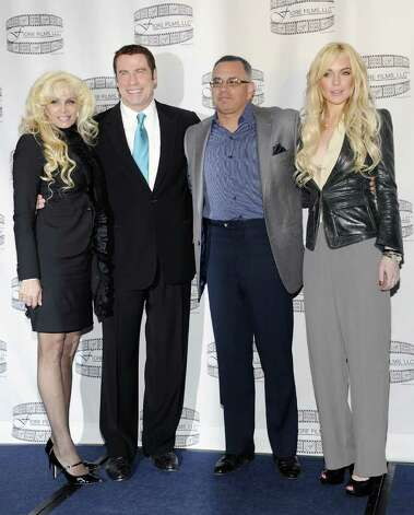 "Victoria Gotti, author and daughter of the late John Gotti, left, actor John Travolta, John Gotti Jr. and actress Lindsay Lohan pose during a news conference for the film ""Gotti: Three Generations"", based on the life of John Gotti, at The Sheraton Hotel on Tuesday, April 12, 2011 in New York. (AP Photo/Evan Agostini) Photo: Evan Agostini"