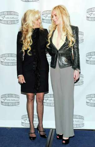 "Victoria Gotti, daughter of John Gotti Sr., left, and actress Lindsay Lohan pose during a news conference for the film ""Gotti: Three Generations"", based on the life of John Gotti, leader of the Gambino crime family, at The Sheraton Hotel on Tuesday, April 12, 2011 in New York. Lohan is currently in talks to star in the film, along with John Travolta, who is confirmed to portray John Gotti in the biopic. (AP Photo/Evan Agostini) Photo: Evan Agostini"