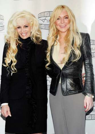 "Victoria Gotti, daughter of John Gotti Sr., left, and actress Lindsay Lohan pose during a news conference for the film ""Gotti: Three Generations"", based on the life of John Gotti, leader of the Gambino crime family, at The Sheraton Hotel on Tuesday, April 12, 2011 in New York. Lohan is currently in talks to star in the film, along with John Travolta, who is confirmed to portray John Gotti in the biopic. Photo: Evan Agostini"