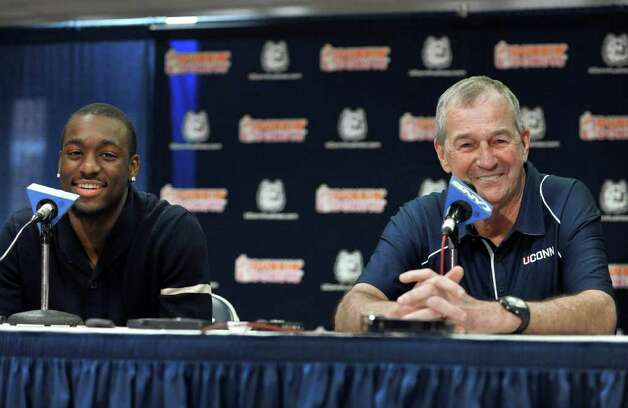 Connecticut's Kemba Walker, left, announces his intentions to enter the 2011 NBA draft during a news conference as Connecticut head coach Jim Calhoun, right, looks on in Storrs, Conn., Tuesday, April 12, 2011. (AP Photo/Jessica Hill) Photo: AP