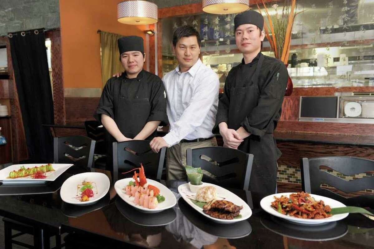 Ken Wong, center, owner of JKoo in Newtown, is photographed with Jin Jiang, left, his executive sushi chef and chef Tiger Sun. Photo taken Wednesday, April 6, 2011.