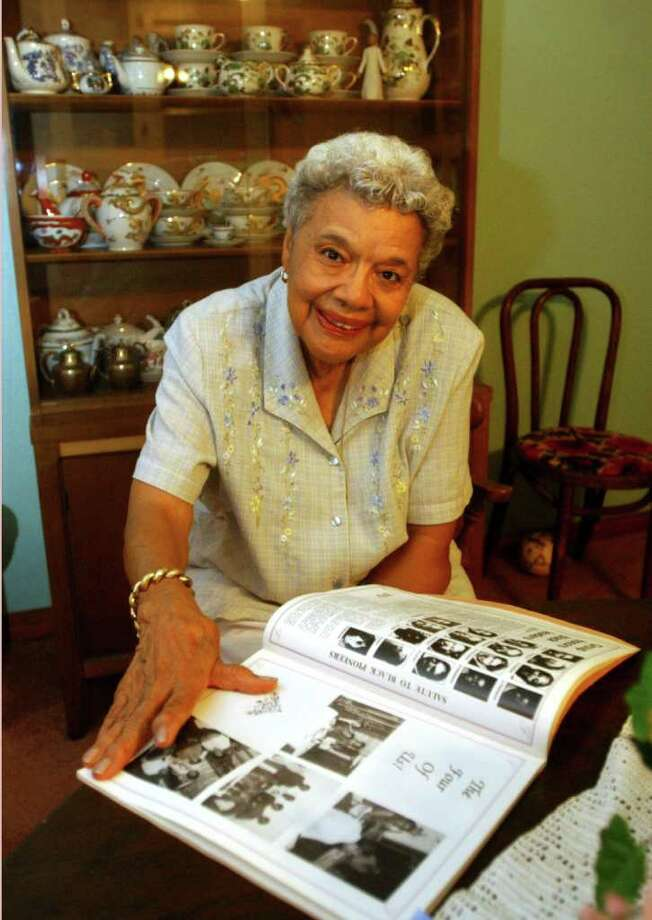 In this Enterprise file photo, Gloria Freeman flips through a book of family history  she assembled. Freeman, a Port Arthur resident and historian, died Saturday at 88.