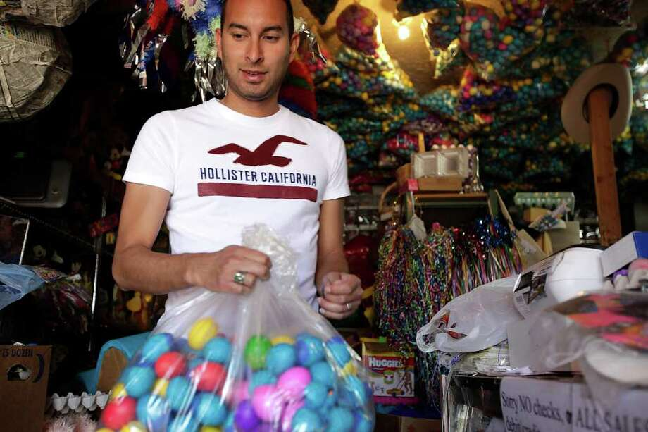 Steve Martinez carries several dozen cascarones he purchased at La Princesa, a store at 1301 Culebra, Tuesday, April 12, 2011. He was planning on using the cascarones over the Fiesta season. Photo: JERRY LARA, SAN ANTONIO EXPRESS-NEWS / SAN ANTONIO EXPRESS-NEWS
