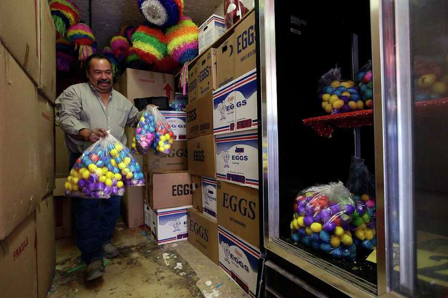 "METRO – Mario Izarraras carries bags of ""cascarones"" for display at La Princesa Gift Shop, a store at 1301 Culebra, Tuesday, April 12, 2011. Although the store sells the eggshells year round, demand for the product goes up during the Easter Season.  JERRY LARA/glara@express-news.net Photo: JERRY LARA, SAN ANTONIO EXPRESS-NEWS / SAN ANTONIO EXPRESS-NEWS"