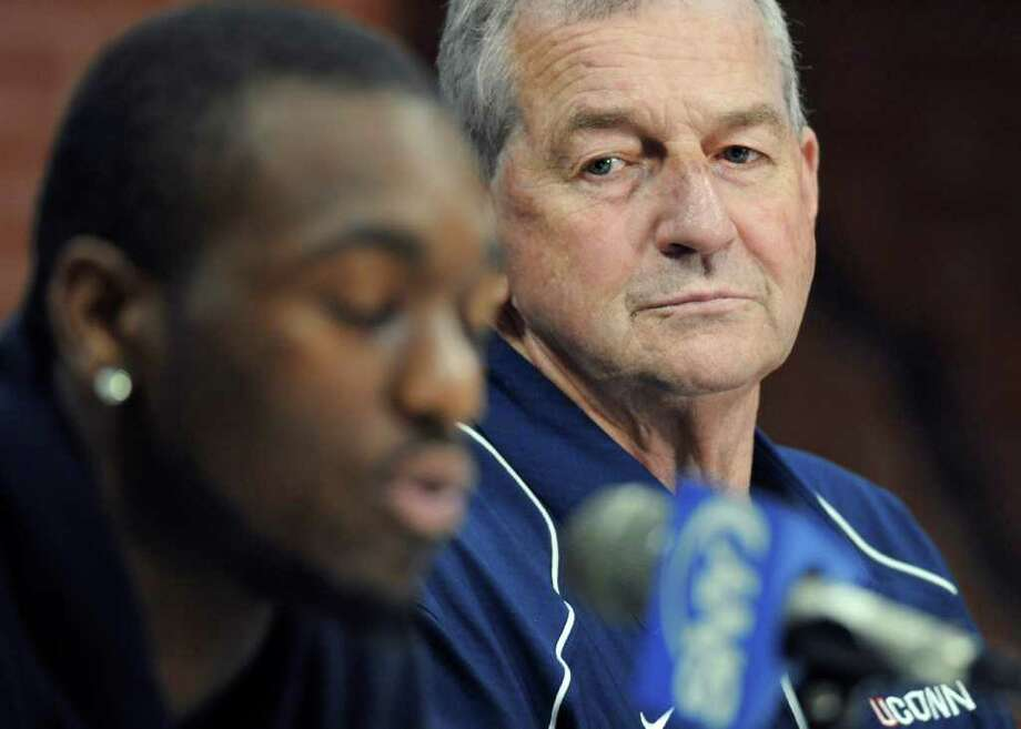 Connecticut coach Jim Calhoun, right, listens as player Kemba Walker discusses his plan to enter the NBA basketball draft, in Storrs, Conn., Tuesday, April 12, 2011. The 6-foot-1 guard led the Huskies to a 32-9 record, including an 11-0 postseason run that ended with a national championship. Walker is expected to be a first-round pick, and perhaps the second guard chosen behind Duke's Kyrie Irving. (AP Photo/Jessica Hill) Photo: AP