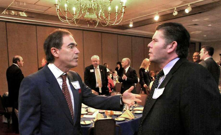 Jay Walker, left, speaks with Stephen Bull, president of the Greater Danbury Chamber of Commerce, during the United Way event at the Amber Room in Danbury, on Wednesday, April 21, 2010. Photo: Michael Duffy, ST / The News-Times