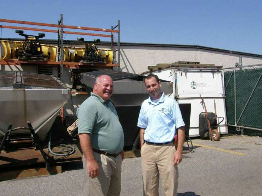 Bruce Moore, left, and his  son Bruce Moore Jr., are celebrating the 35th anniversary of Eastern Land Management in Stamford, which has grown into a business with 65 employees and serving corporate clients throughout the region. Photo: Contributed Photo / Connecticut Post Contributed
