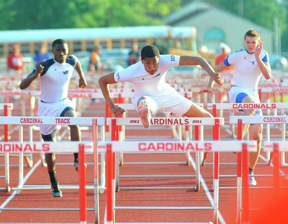 WO-Stark hurdler Phillip Jones, center,  has the lead to the finish in the 100 meter hurdles at the District 21-3A track and field meet at Bridge City High School on Tuesday, April 12, 2011.  Valentino Mauricio/The Enterprise Photo: Valentino Mauricio / Beaumont
