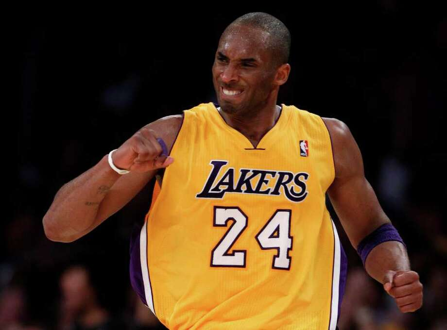 Los Angeles Lakers' Kobe Bryant celebrates after making a three-point basket against the San Antonio Spurs during the second half of an NBA basketball game in Los Angeles, Tuesday, April 12, 2011. Photo: AP