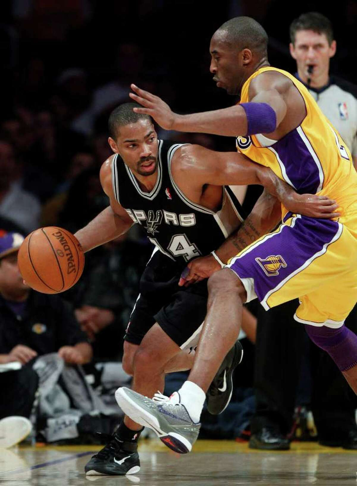 San Antonio Spurs' Gary Neal, left, drives around Los Angeles Lakers' Kobe Bryant during the first half of an NBA basketball game in Los Angeles, Tuesday, April 12, 2011.