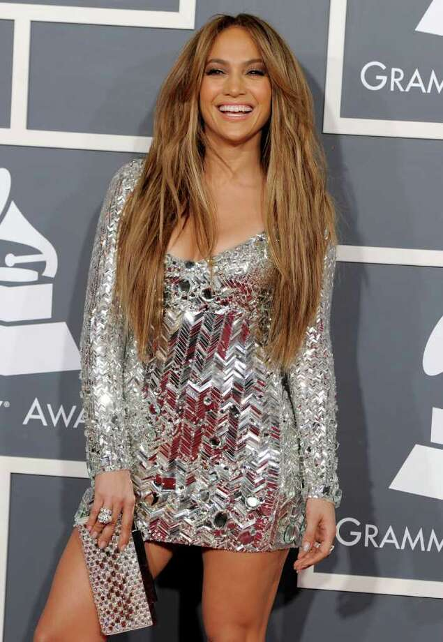 "FILE - In a Feb. 13, 2011 file photo, Jennifer Lopez arrives at the 53rd annual Grammy Awards, in Los Angeles. People magazine is naming Jennifer Lopez the World's Most Beautiful Woman. The singer, actress and ""American Idol"" judge tops the magazine's annual list of ""the World's Most Beautiful"" in a special double issue. Photo: AP"