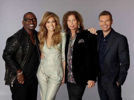"In this undated publicity image released by Fox, judges for season ten of ""American Idol"", from left, Randy Jackson, Jennifer Lopez, Steven Tyler are shown with host Ryan Seacrest. Photo: AP"