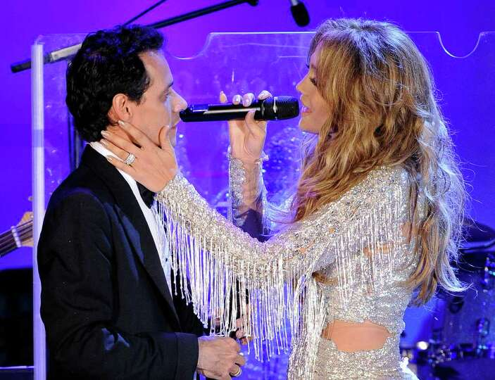 Marc Anthony and Jennifer Lopez perform at the Carousel of Hope ball to benefit The Barbara Davis Ce